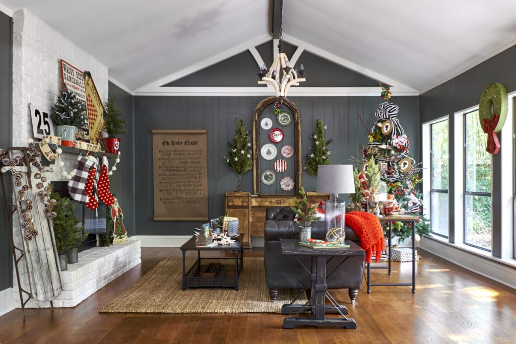 decorating with multiple Christmas trees